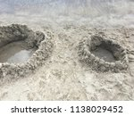sand castle built by the child... | Shutterstock . vector #1138029452