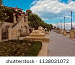 people stroll along the... | Shutterstock . vector #1138031072