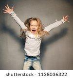 screaming girl. crazy child.... | Shutterstock . vector #1138036322