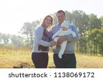happy family with the child in... | Shutterstock . vector #1138069172