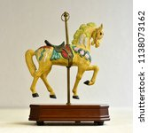 toy yellow horse carousel... | Shutterstock . vector #1138073162