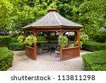 Gazebo In Landscaped Garden...