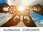 four hands of businessmen... | Shutterstock . vector #1138124642