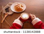 woman santa claus hands holding ... | Shutterstock . vector #1138142888