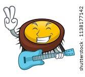 with guitar sea urchin mascot... | Shutterstock .eps vector #1138177142