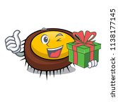 with gift sea urchin mascot... | Shutterstock .eps vector #1138177145