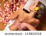 young woman in spa massage... | Shutterstock . vector #113824318