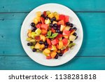 mixed summer fruits salad top... | Shutterstock . vector #1138281818