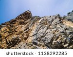 big mountain cliff under cloudy ... | Shutterstock . vector #1138292285