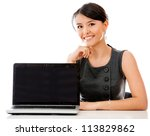 Business woman with a laptop facing the camera - isolated over white - stock photo