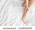 beautiful woman sitting on bed... | Shutterstock . vector #1138356905