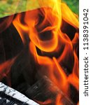 burning firewood in a brazier | Shutterstock . vector #1138391042