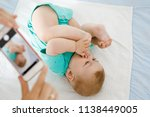 parent taking photo of a baby... | Shutterstock . vector #1138449005
