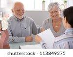 senior couple sitting at desk... | Shutterstock . vector #113849275