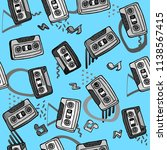 pattern old film cassettes on a ... | Shutterstock . vector #1138567415