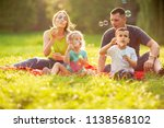 young family with children blow ... | Shutterstock . vector #1138568102