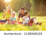 happy family in the park... | Shutterstock . vector #1138568105