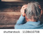 Small photo of Adult woman has a headache. She sitting head in hands on dark black room. Concept dramatic loneliness, sadness, depression, sad emotions, cry, disappointed,healthcare, pain.