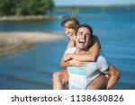 romantic couple playing... | Shutterstock . vector #1138630826