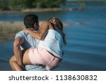 romantic couple playing... | Shutterstock . vector #1138630832