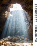 beautiful sunbeam in the cave | Shutterstock . vector #1138686995