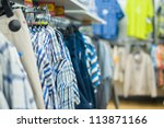Variety os t-shirts on stands in supermarket - stock photo