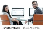 successful employees sitting at ... | Shutterstock . vector #1138713248