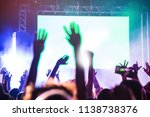rear view of crowd watching and ... | Shutterstock . vector #1138738376