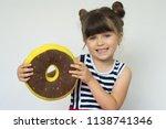 smiling pleased pretty kid.  | Shutterstock . vector #1138741346