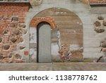 old door in the fortress | Shutterstock . vector #1138778762