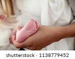 feet of a newborn baby | Shutterstock . vector #1138779452
