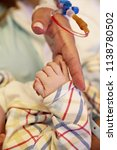 hands of a family  mother ... | Shutterstock . vector #1138780502