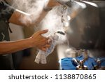 hand of barista cleaning... | Shutterstock . vector #1138870865