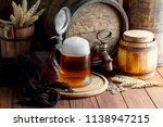 light foam beer in a glass on... | Shutterstock . vector #1138947215