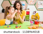 preschool student and teacher | Shutterstock . vector #1138964018
