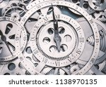 a metal gear in a clock. | Shutterstock . vector #1138970135