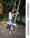 young woman in backyard summer... | Shutterstock . vector #1138980602
