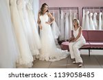 bride and friends shopping for... | Shutterstock . vector #1139058485