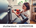 woman working on a new kitchen... | Shutterstock . vector #1139059538