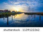 sunset village river water...