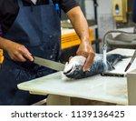 man filleting salmon on white... | Shutterstock . vector #1139136425