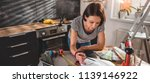 woman wearing striped shirt... | Shutterstock . vector #1139146922