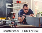 man using angle ruler while... | Shutterstock . vector #1139179352