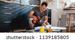man working on a new kitchen... | Shutterstock . vector #1139185805