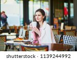 beautiful young woman drinking... | Shutterstock . vector #1139244992