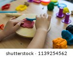 the kid play with play dough in ... | Shutterstock . vector #1139254562