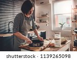woman preparing apple pie crust ... | Shutterstock . vector #1139265098