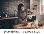 woman standing in the kitchen... | Shutterstock . vector #1139265128