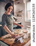 woman standing in the kitchen... | Shutterstock . vector #1139265155