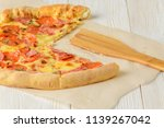 pizza cheese board on a wooden... | Shutterstock . vector #1139267042